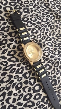 round gold-colored analog watch with link bracelet 779 mi