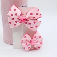 two pink bow ribbons