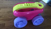 toddler's pink and yellow plastic toy 42 km