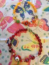 red and yellow beaded necklace Alexandria, 22311