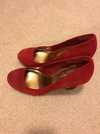 women's pair of red suede pumps