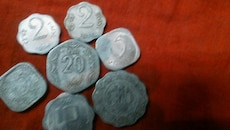 seven assorted silver Indian coins