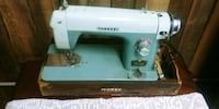 blue and white Morse sewing machine