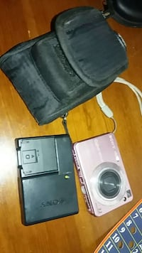 pink digital camera with battery charger and case