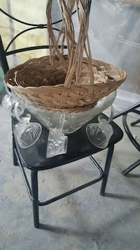 brown wicker basket; clear cut glass punch bowl set