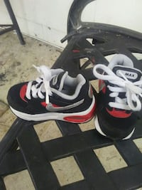 pair of black-and-white Nike running shoes Cleveland, 37323