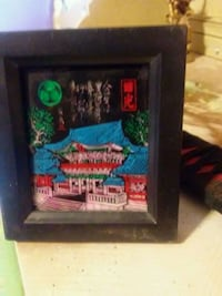 black wooden framed painting of the world of Wilson, 27896