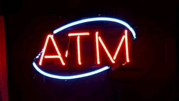 Neon ATM sign.