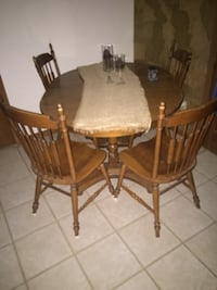 Round brown pedestal table and windsor chairs San Antonio