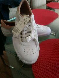 All white leather Adidas Anaheim, 92804