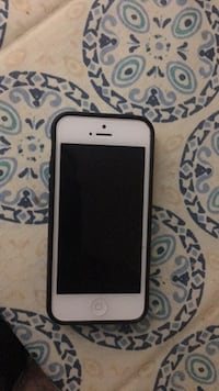 white iPhone 5 with black case 3742 km
