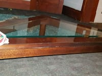 brown wooden framed glass-top TV stand 2136 km