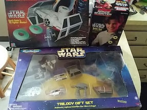 three Star Wars gift set boxes older stock