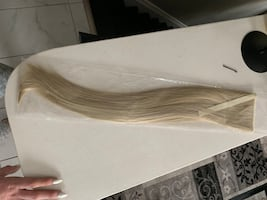 Blonde pony tail extension