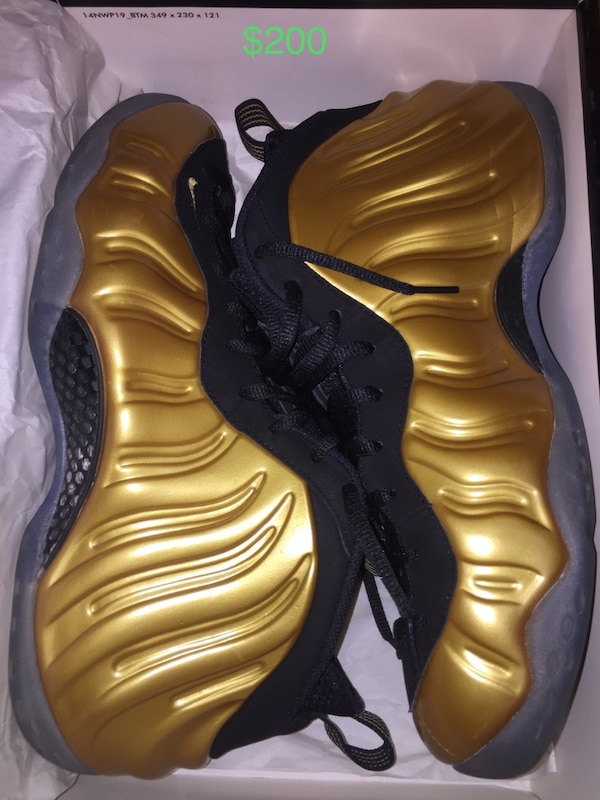pair of brown Nike Foamposite