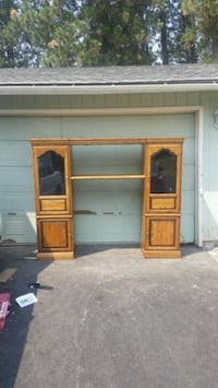 brown wooden TV hutch with flat screen television Mead, 99021