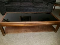 brown wooden framed glass top coffee table Oklahoma City, 73142