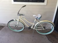 white and blue cruiser bike null