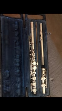 silver flute with black case
