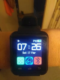 black smartwatch with black band Whitby, L1N 4B9