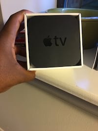 Black apple tv in box with remote Baltimore, 21202