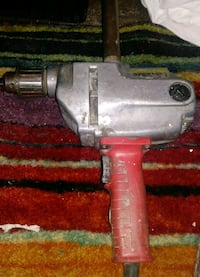 gray and red corded power tool 2272 mi