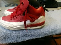 pair of red Air Jordan basketball shoes Fayetteville, 28306