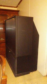 black flat screen TV with brown wooden TV stand Warner Robins, 31093