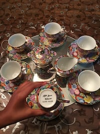 Pink and white floral paint teacup set Pickering, L1V