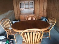 Table and chairs and hutch