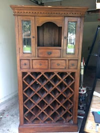 brown wooden framed glass cabinet 663 mi