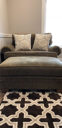 Upholstered olive green loveseat with throw pillows and ottoman in great condition Sammamish, 98075