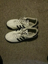 white-and-black Adidas low-top sneakers