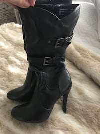 pair of women's black leather side-zip buckled high-heeled biker boots