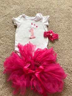 Baby's white crewneck onesie and pink tutu skirt outfit