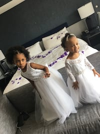 Two white flower girls dresses 150 for both or $70 a piece Baltimore, 21229