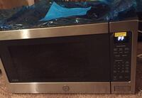 black and gray microwave oven 11 km