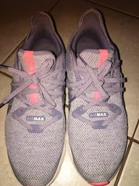 pair of gray Nike running shoes 2219 mi