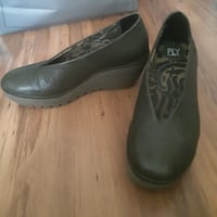 pair of green leather dress shoes null