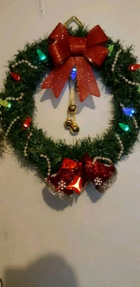 green garland and red ribbon Christmas wreath 506 km