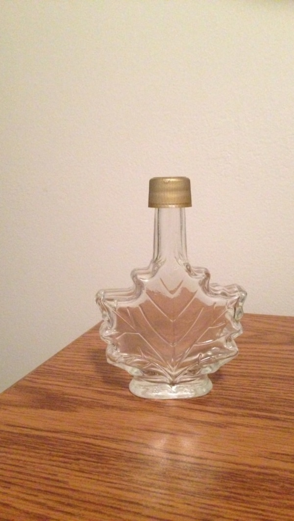 Clear glass maple leaf bottle