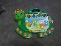 green and yellow Vtech learning table 376 mi