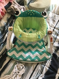 green and white Fisher-Price frog sit-me-up floor seat