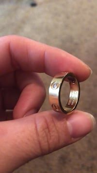 gold-colored and black ring 2330 mi