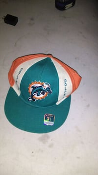 teal, white, and orange Dolphin fitted cap