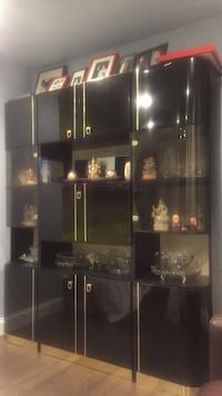 Black wooden display china with glass door and also gold trim. Paramus NJ location. Must pick up from the house. Purchase from Macy's furniture store for $4500.00 2 years ago. Paramus, 07652