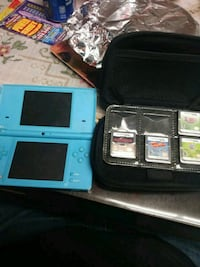 white Nintendo 3DS with game cartridges Delhi, 95315