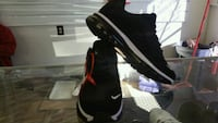 pair of black-and-white Nike running shoes 817 mi
