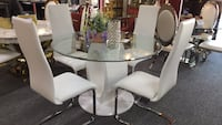 round clear glass-top table with chairs Irving, 75062