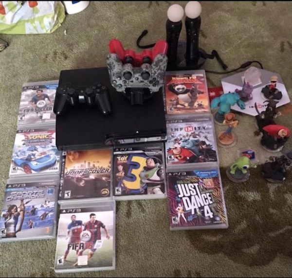 assorted PS3 game cases and controllers